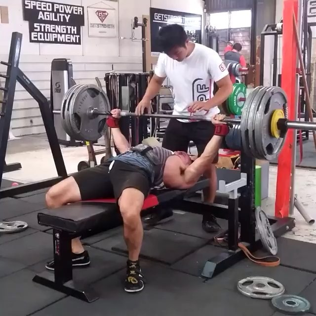 Supreme leader @johnstrachan_pl leading by example. 143x3 on the bench for a new 3RM. Micro loading is the key to breaking plateaus.
